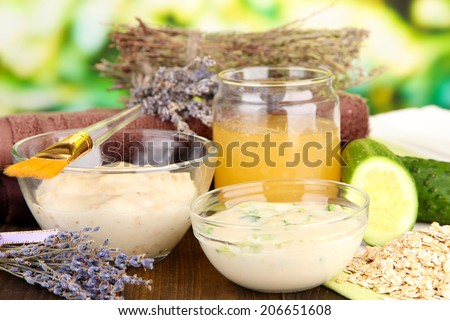 Homemade facial masks with natural ingredients, on color wooden table, on bright background - stock photo