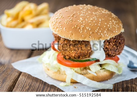 Homemade Falafel Burger (detailed close-up shot; selective focus) on a wooden table