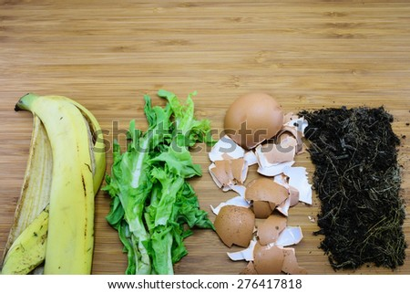 homemade fertilizer made from kitchen scraps such as banana peel, vegetable, eggshell and soil - stock photo