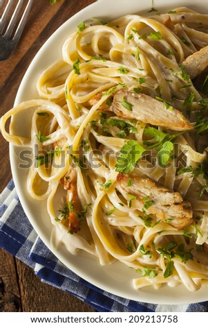 Homemade Fettucini Aflredo Pasta with Chicken and Parsley - stock photo