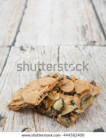 Homemade florentine biscuits over wooden background