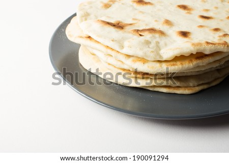 Homemade flour tortillas, served on a plate - stock photo