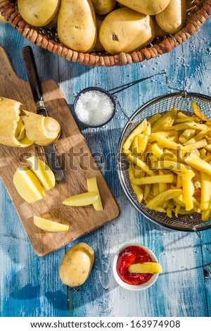 Homemade French fries made from potatoes - stock photo