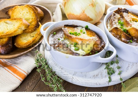 Homemade French onion soup with toasted baguette.