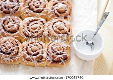 homemade fresh cinnamon buns - sweet food - stock photo