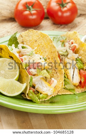 Homemade fresh fish tacos on a green plate