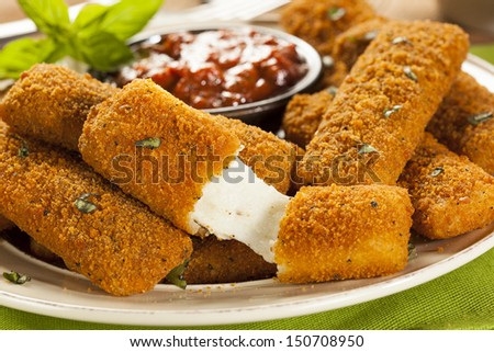 Homemade Fried Mozzarella Sticks with Marinara Sauce - stock photo