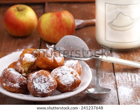 Homemade fritters on wooden background. Traditional Croatian cookies called fritule. - stock photo