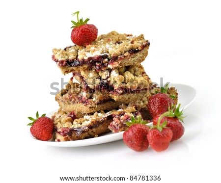 homemade  fruit bars filled with strawberry jam and fresh berries - stock photo