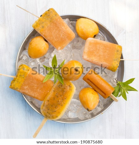 homemade fruit popsicles on ice cube - stock photo
