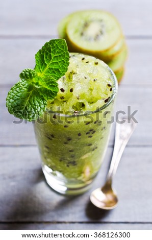 Homemade fruit sorbet in a glass on a wooden background. Selective focus. - stock photo
