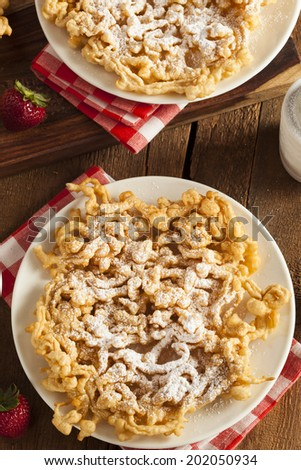 Homemade Funnel Cake with Powdered Sugar at the Fair - stock photo