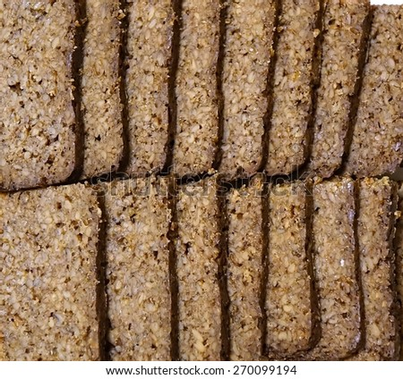 Homemade German pumpernickel made from cracked rye  - stock photo