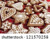 Homemade gingerbread cookies on the grid for cooling. - stock photo