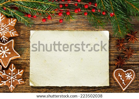 Homemade gingerbread cookies on wooden table. Empty space for your text - stock photo