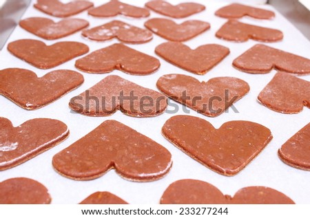 Homemade gingerbread dough for Christmas cookies, shape of heart - stock photo