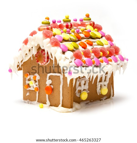 Homemade gingerbread house a a model house made of gingerbread. A traditional Christmas decoration.