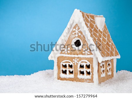 Homemade gingerbread house on blue background  - stock photo