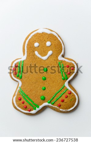 Homemade gingerbread man over white background, above view - stock photo