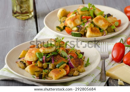 Homemade gnocchi with Mediterranean vegetables, with herbs and parmesan, san marzano tomatoes - stock photo