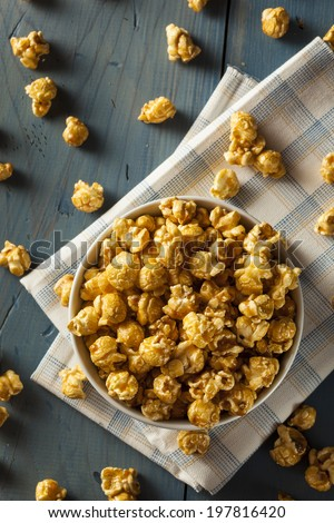 Homemade Golden Caramel Popcorn in a Bowl - stock photo