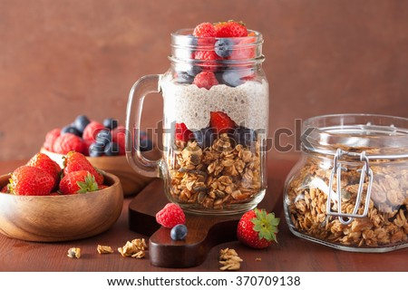 homemade granola and chia seed pudding with berry healthy breakfast - stock photo