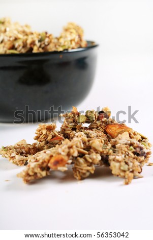 homemade granola in a black bowl - stock photo