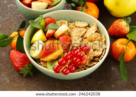 homemade granola muesli with fruit salad for breakfast - stock photo