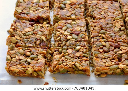 Homemade granola squares with almonds, oats and pumpkin seeds shot in natural light