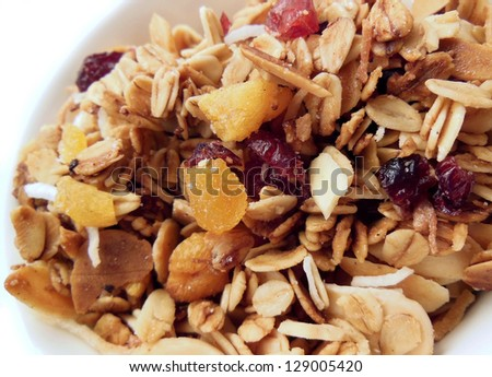 Homemade granola with oats, coconut, cranberries, apricot and almond slivers - stock photo