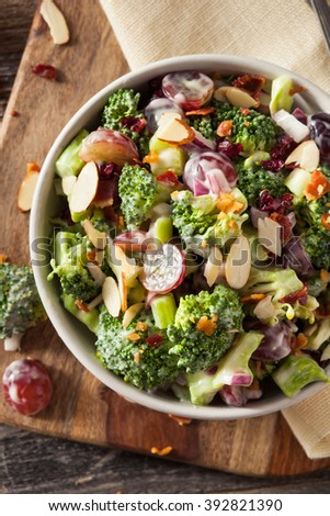 Homemade Green Broccoli Salad with Grapes Onion and Bacon - stock photo