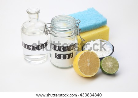 Homemade green cleaning.Lemon and baking soda on white background - stock photo