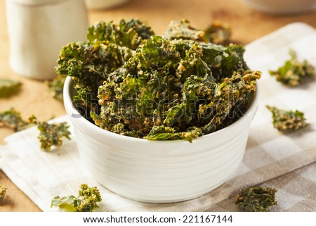 Homemade Green Kale Chips with Vegan Cheese - stock photo