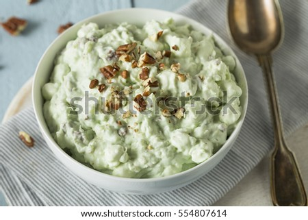 Homemade Green Pistachio Fluff Dessert with Pecans and Marshmallows