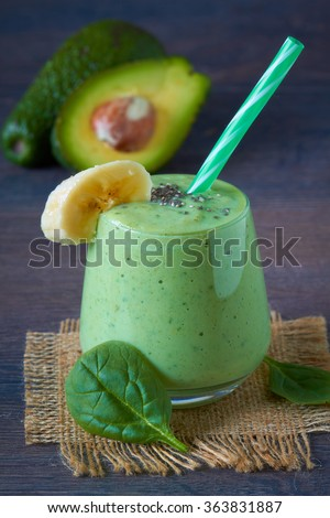Homemade green smoothie on dark wooden table