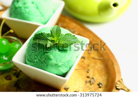 Homemade green tea ice-cream on light wooden background