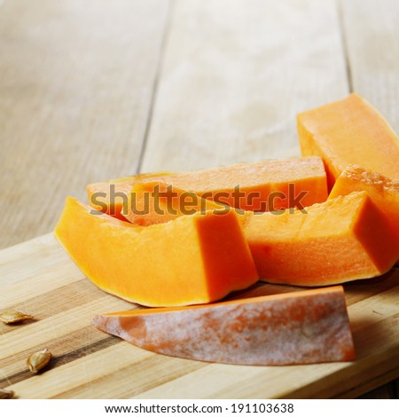 Homemade halloween pumpkin slices on cutting board