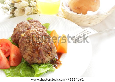 Homemade hamburger steak served with bread and juice
