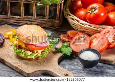 Homemade hamburger with chicken and fresh vegetables