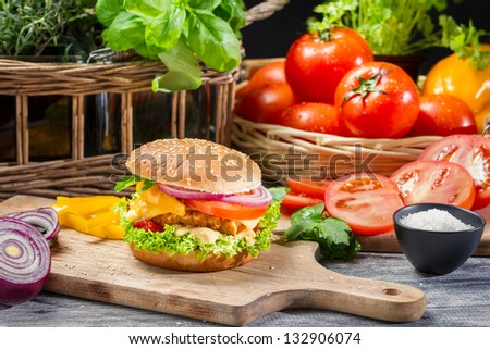 Homemade hamburger with chicken and vegetables - stock photo