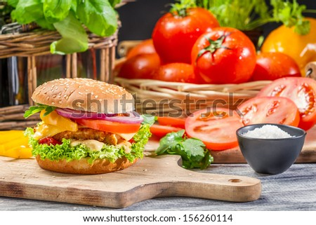 Homemade hamburger with chicken and vegetables