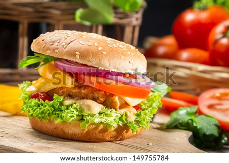Homemade hamburger with chicken, tomato  and onion
