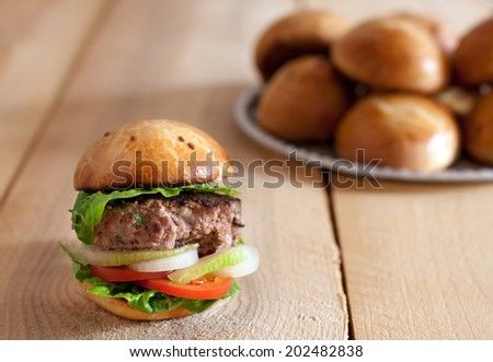 homemade hamburger with fresh vegetables - stock photo