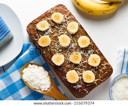 Homemade healthy banana and chia seed bread with coconut flour over white - stock photo