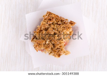 Homemade healthy flapjacks.  Oat bars with honey and currant. Top view.  - stock photo