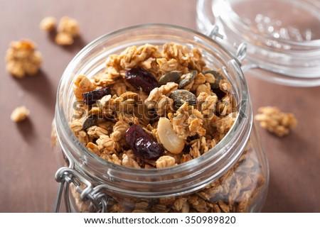 homemade healthy granola in glass jar - stock photo