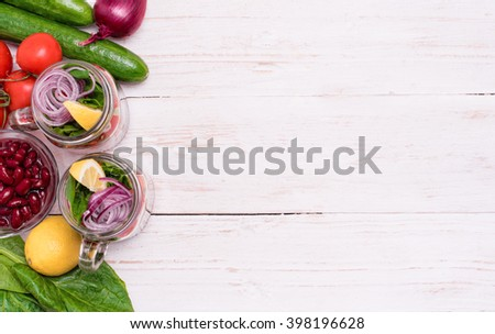Homemade healthy salad in glass jar. Vegetarian concept. Background. - stock photo