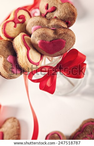Homemade Heart Shape Cookies On Stick In A Glass.