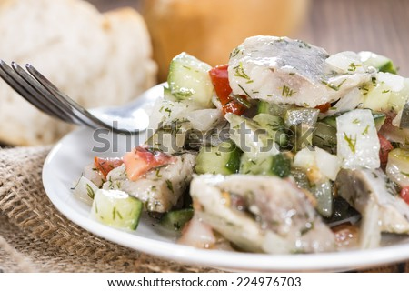 Homemade Herring Salad with fresh baked Baguette