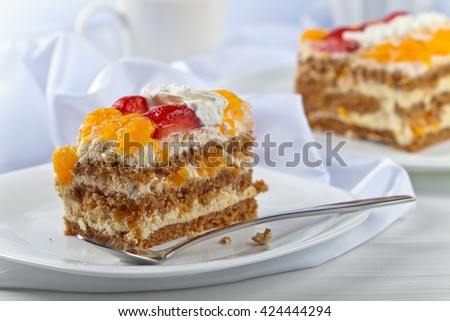 Homemade honey cake with strawberries and orange - stock photo